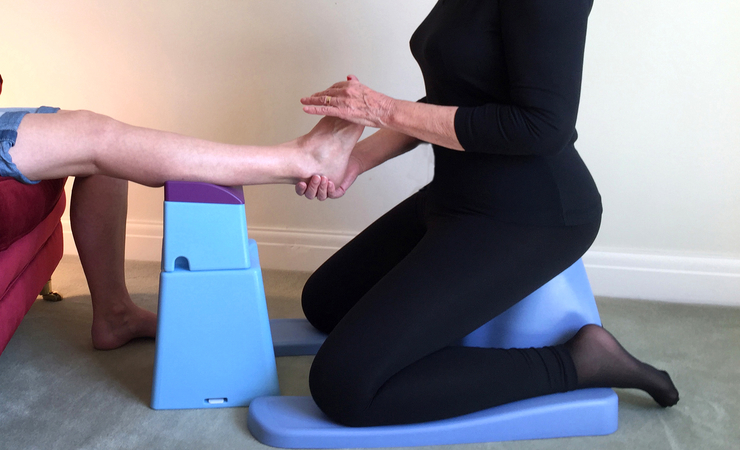 ergokneeler and ergoraiser being used while treating a patient's feet